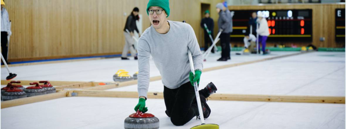 Johnny tries curling for the first time at a Drivemode team retreat.